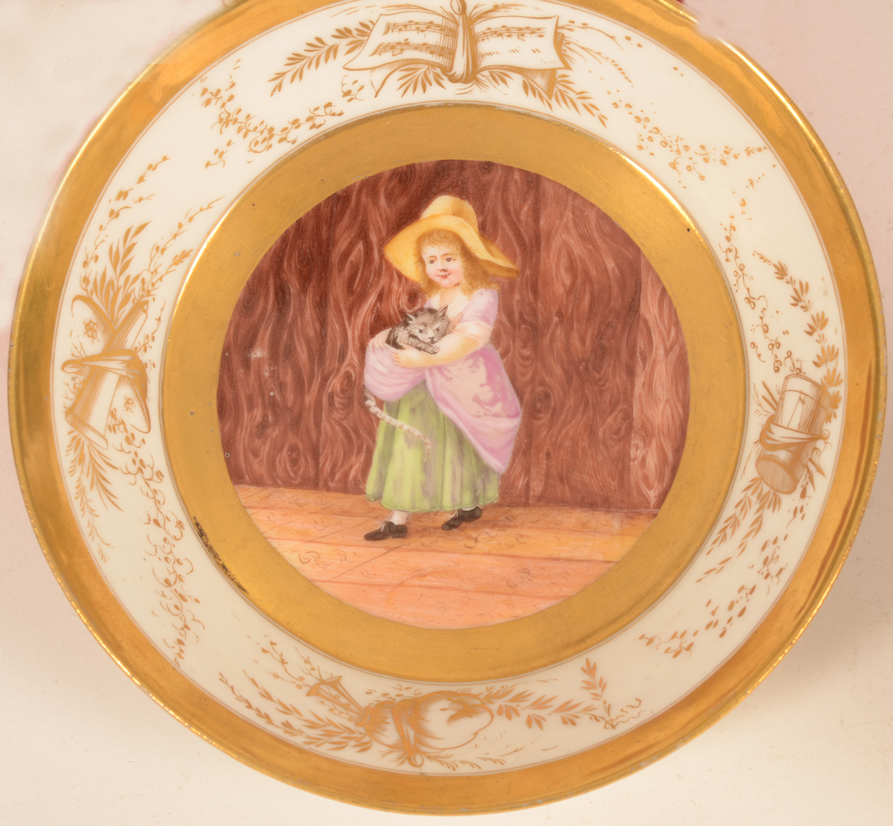 Allegorical porcelain cup and saucer — Detail of the painting on the saucer, of a girl holding a cat
