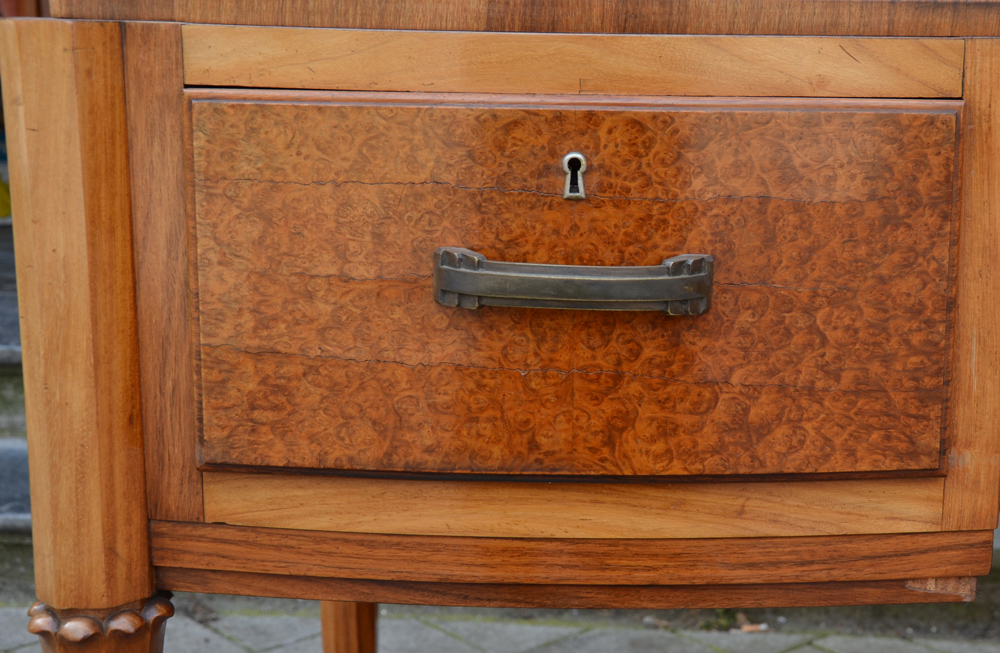 Art Deco desk — detail of the left drawer, showing a small missing part of the verneer at the right corner