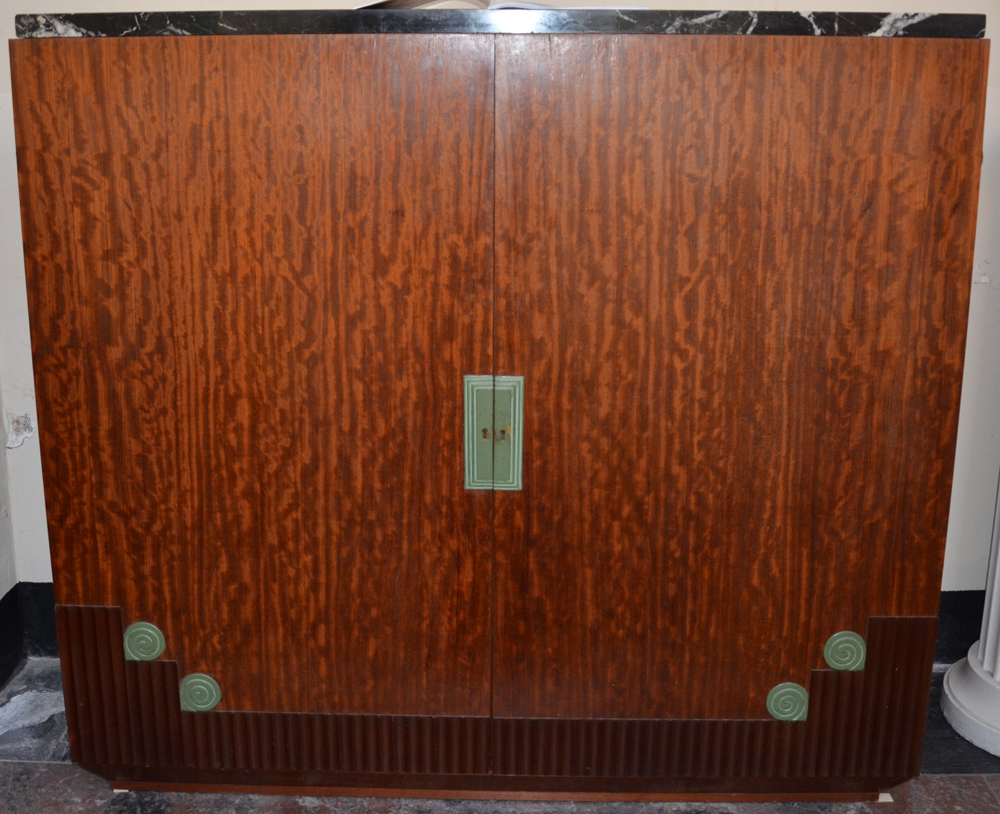 An early Art Deco Sideboard in mahogany, patinated metal and marble.