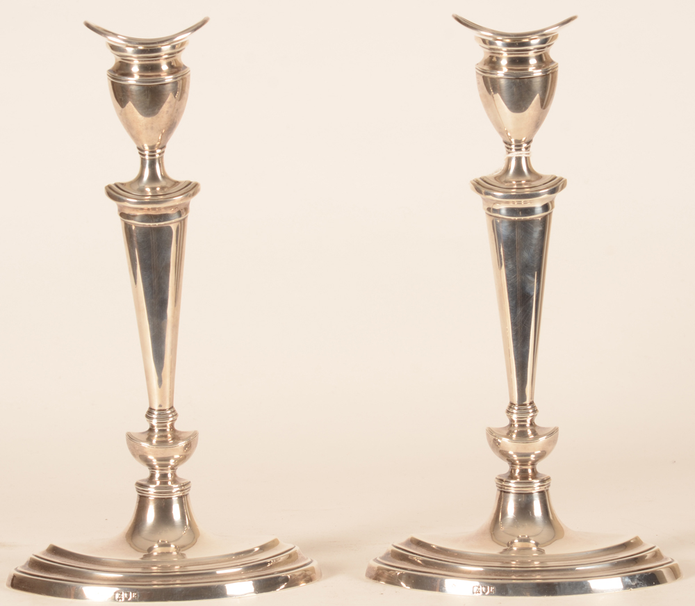 Pair of silver candlesticks — Made by Thomas Bradbury and Sons, marked
