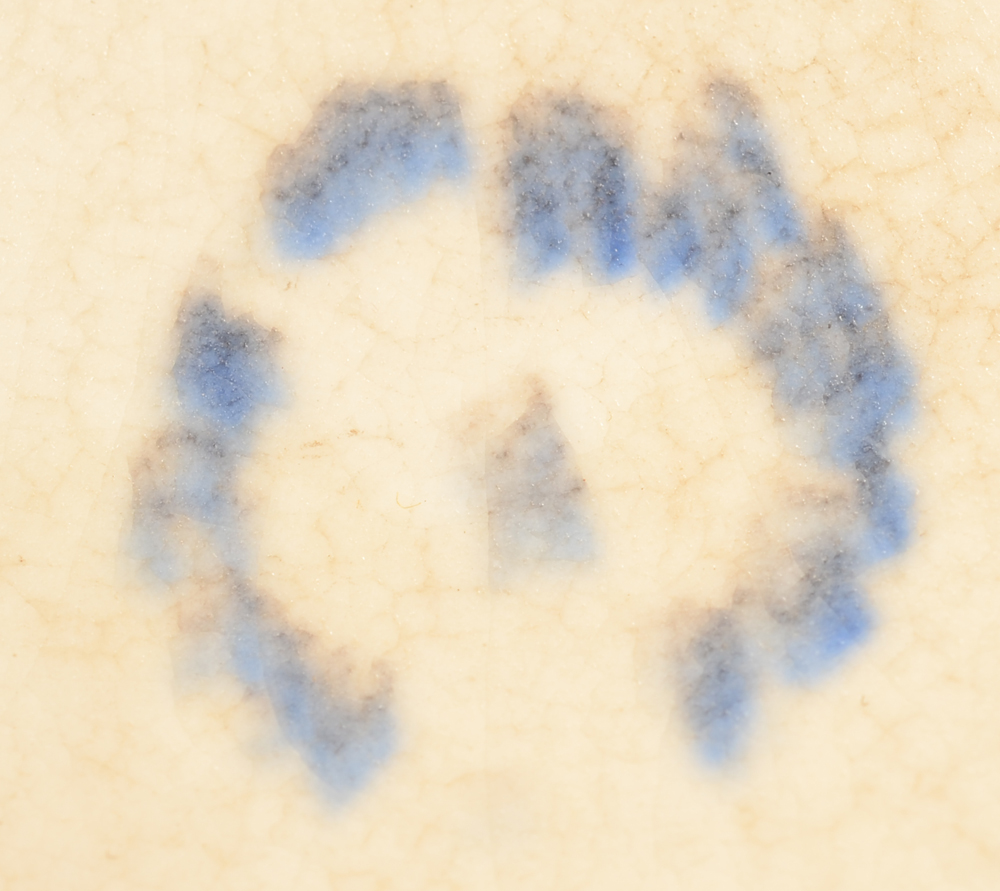 Ceramique de Bruxelles — blurred but typical circular mark of the manufacture at the bottom of the base