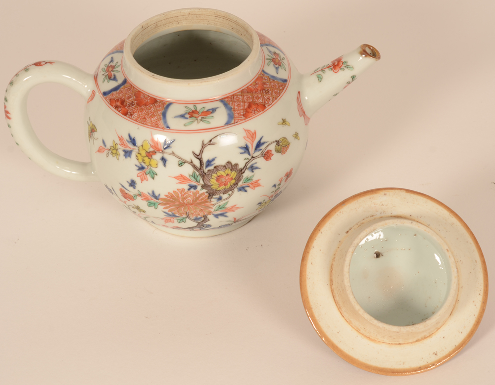 A Chinese porcelain teapot in famille verte enamels