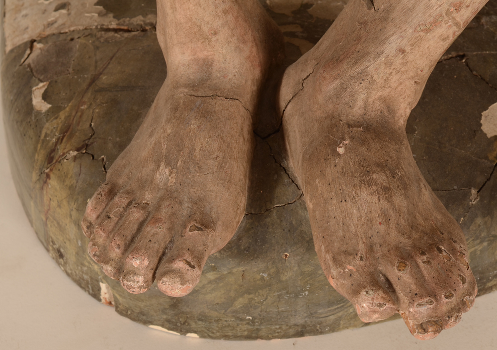Christ on the cold stone — Detail of the feet, one toe missing