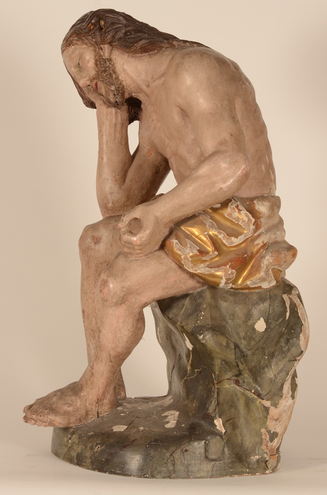 Christ on the cold stone — Left hand side of the sculpture