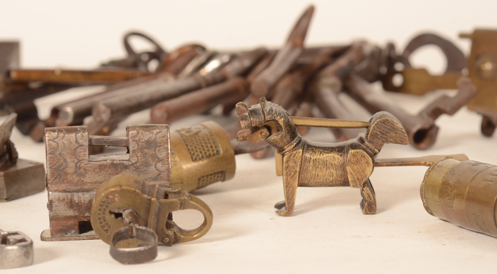 Collection of locks and keys — Detail, with a Chinese doglike lock
