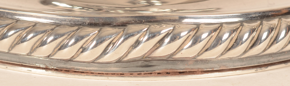Gebrüder Deyhle — Detail of the dent into the rim of the base of one of the candlesticks