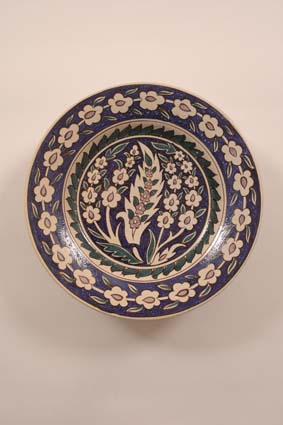 "1955-1965 — 'Iznik' dish, diam. 37 cm, signed ""JM"" (bottom)."