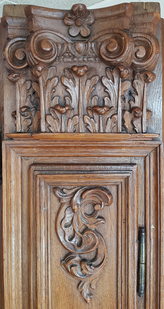 Flemish regence armoire — Detail of the one of the capitals at the side