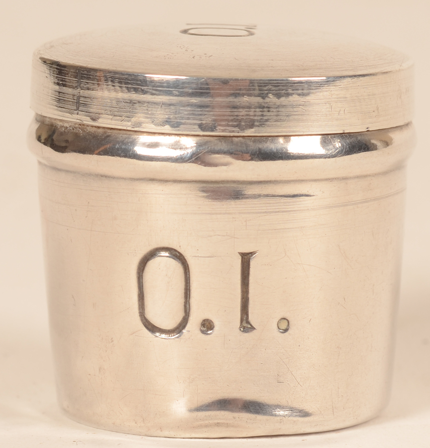Holy oil container — Frontal view showing some of the dents in the silver