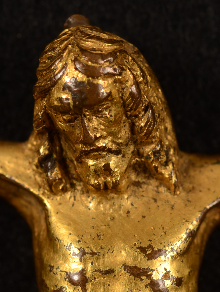 Gilt bronze christ — Detail of the head, showing the quality of the chiseling
