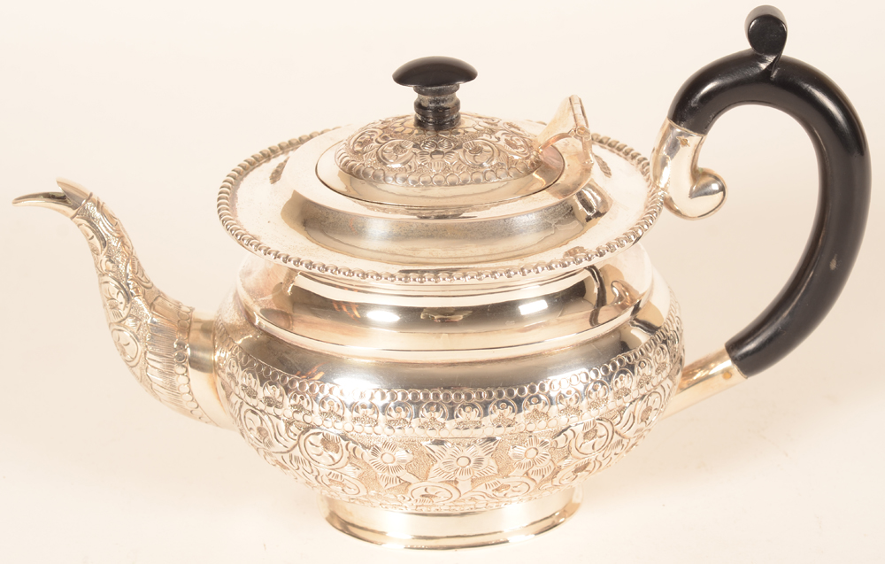 Indian silver tea pot — Side view
