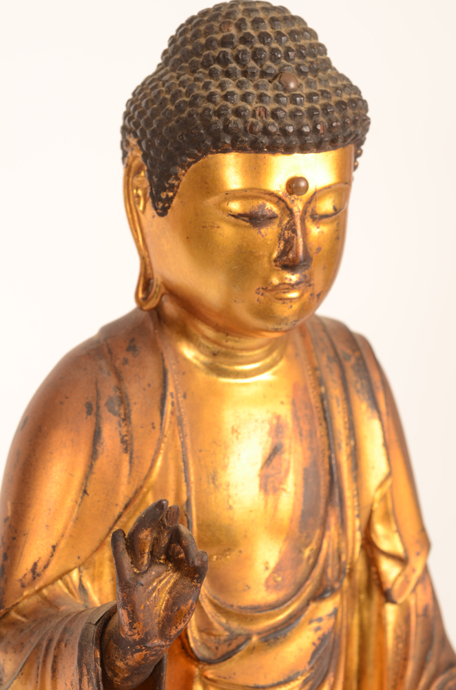 Japanese buddha — <p>Detail of the top part, showing a finger missing a piece, and damage due to age&nbsp;</p>
