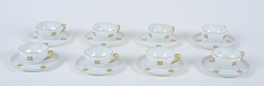 Art Nouveau cups and saucers — Showing the complete set of 8 cups and saucers
