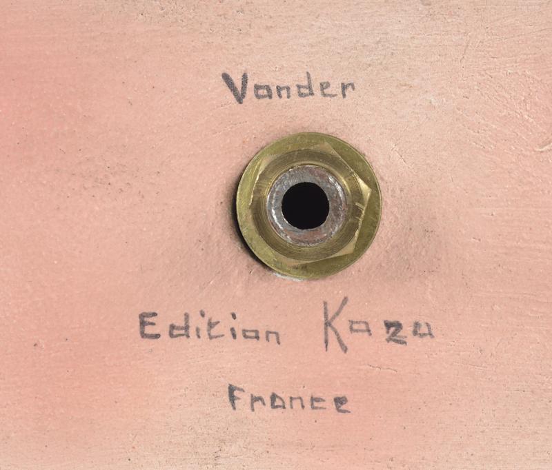 Kaza — Signature at the bottom of the base.