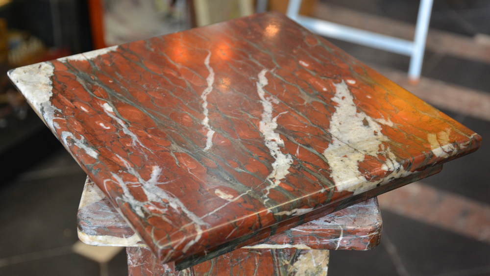 Marble Pedestal — The pedestal has a swivel top in good condition