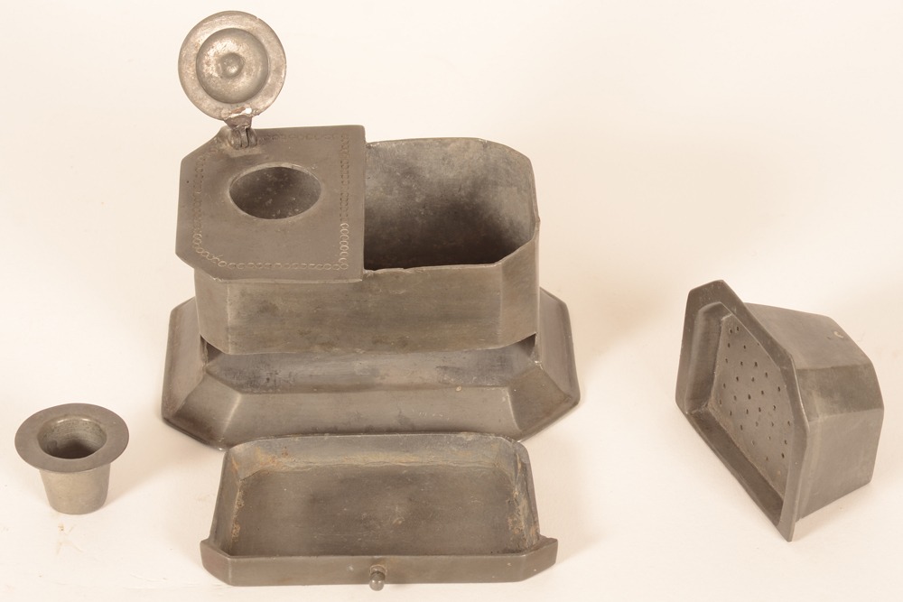 Pewter inkwell — the inkwell with all its compartiments open