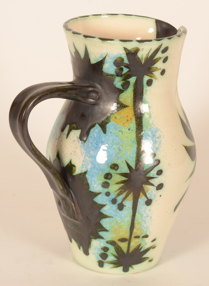 Ceramic Vallauris style black phenix pitcher — The black handle well balanced and backside decorated in black patterns painted over blues, greens and ochres