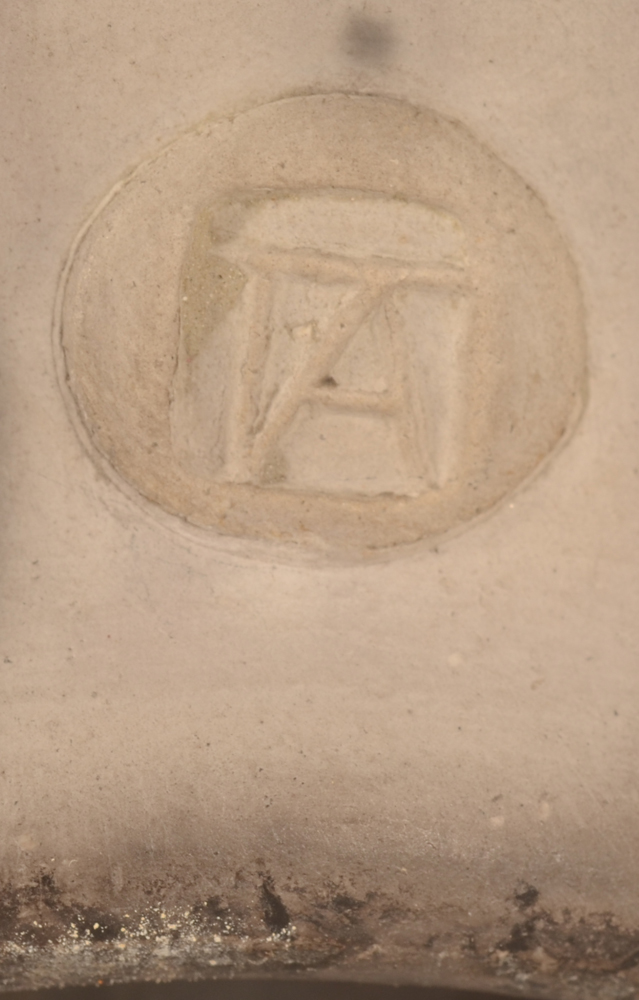 Potter TA — Monogram mark near the base of the vase