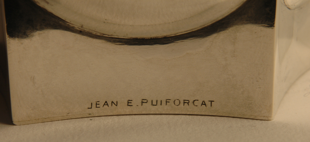 Jean E. Puiforcat — Signature of the artist near the base of the vase.