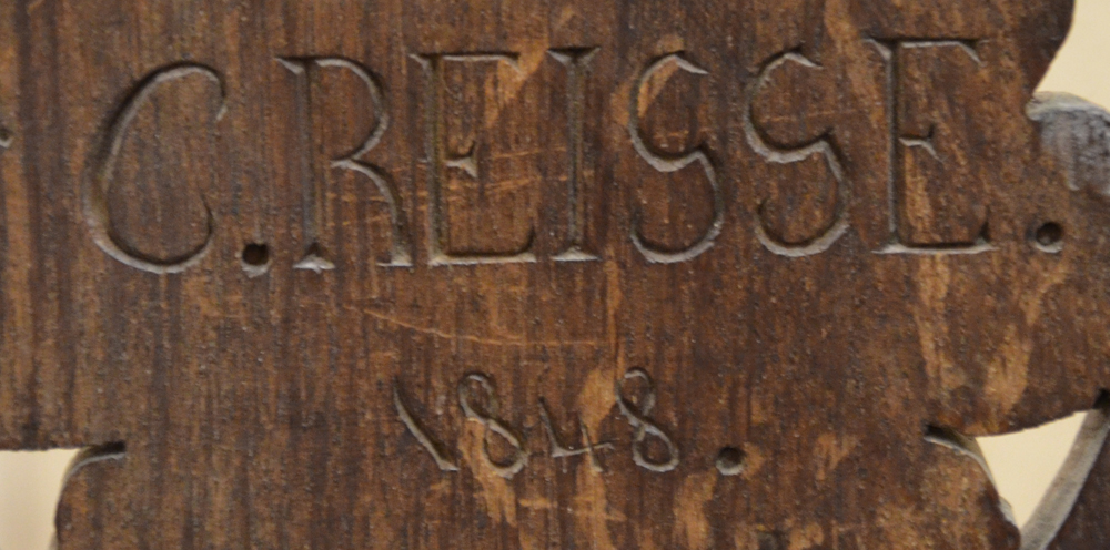 Reisse C. — Carved signature and date 1848