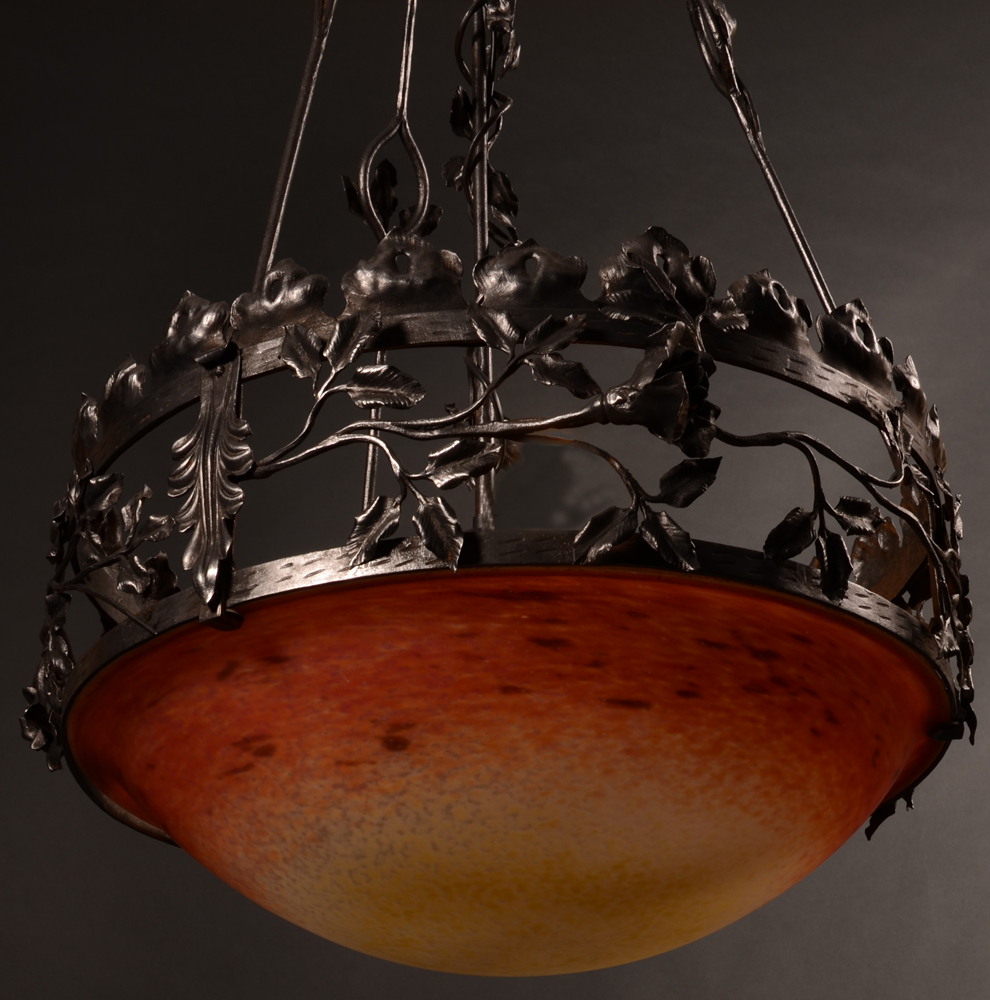 Schneider celing light — Schneider ceiling light in its patinated wrought iron frame, photographed by day.