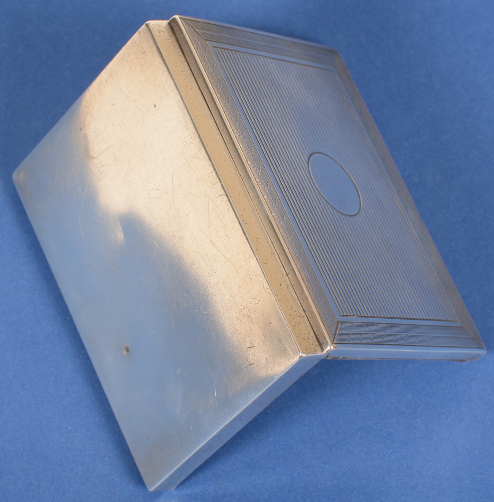 silver card case circle — Back of the case