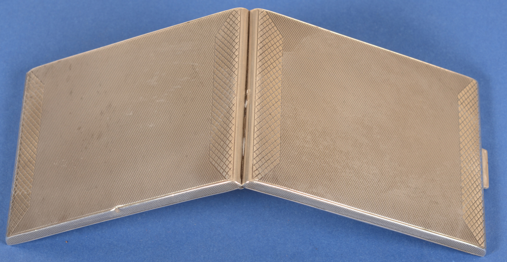 silver cigarette case art deco German — Back of the case, showing the dent to the edge of the left panel