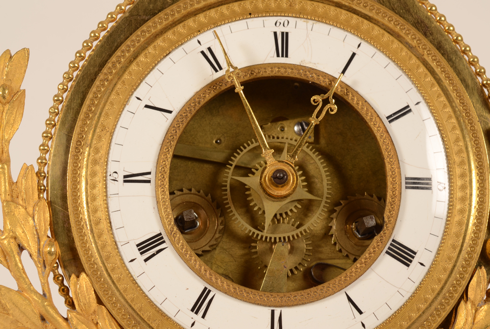 Skeleton Clock — Detail of the dial.