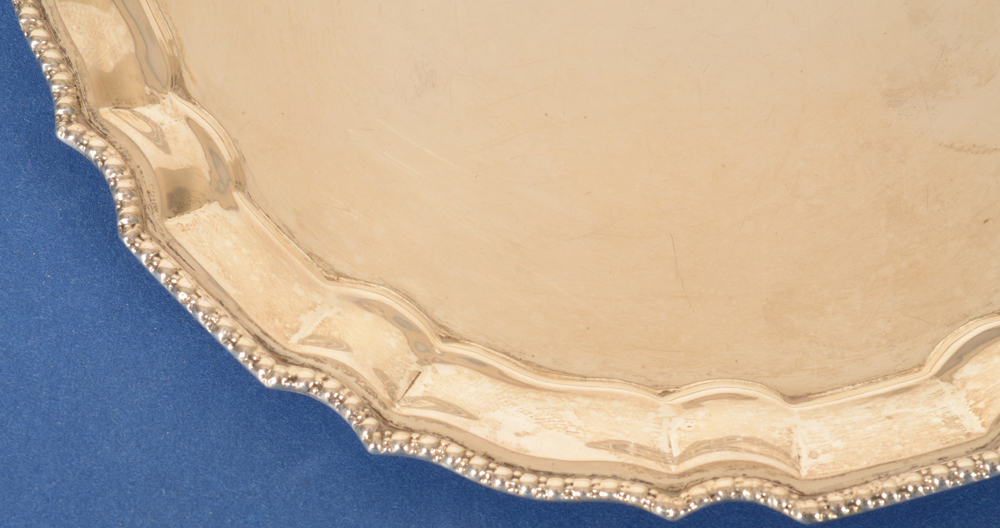 Silver salver — Detail of the decorative motif on the border