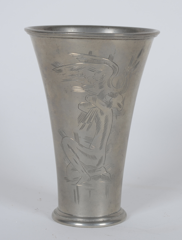 Svenskt Tenn — A typical Scandinavian beaker, with engraved decoration of a sitting nude and a bird, in pewter, marked on the bottom.