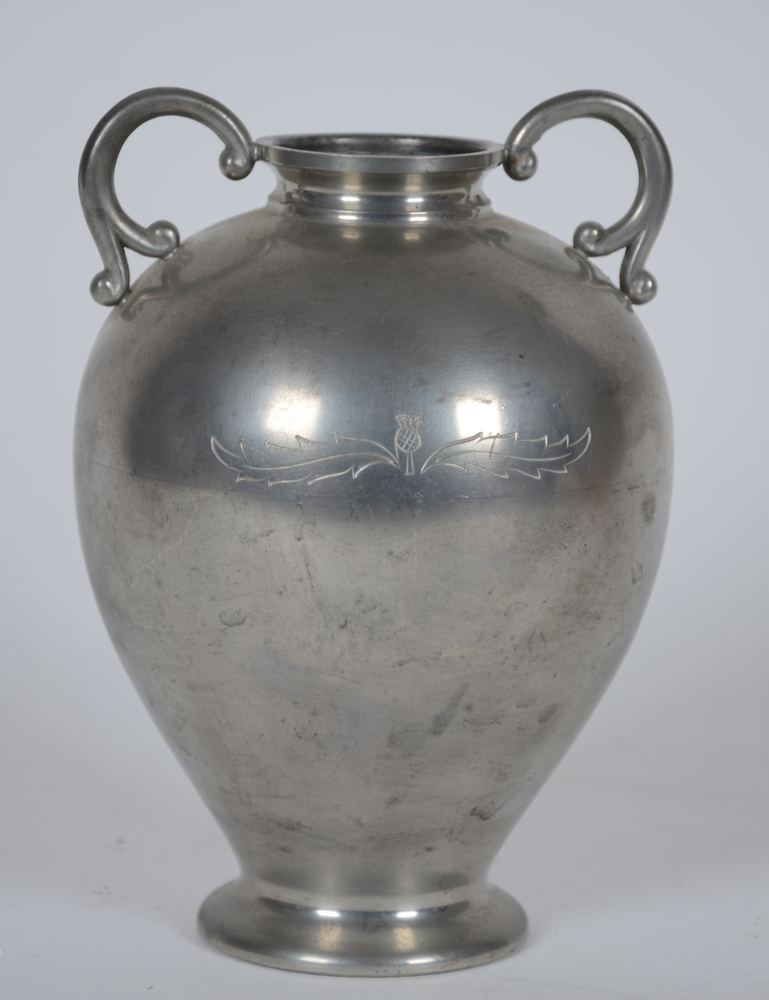 Svenskt Tenn — A two handled vase, in pewter, with an engraved flower motif.
