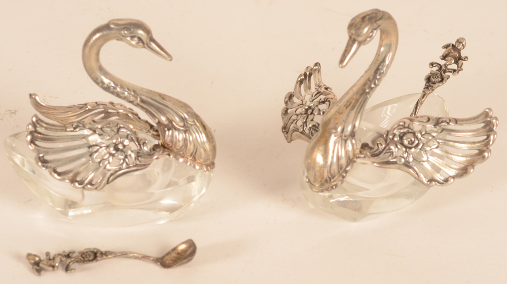 Swann salts — the salts with the original spoons, one salt with wings open, the other salt with wings closed