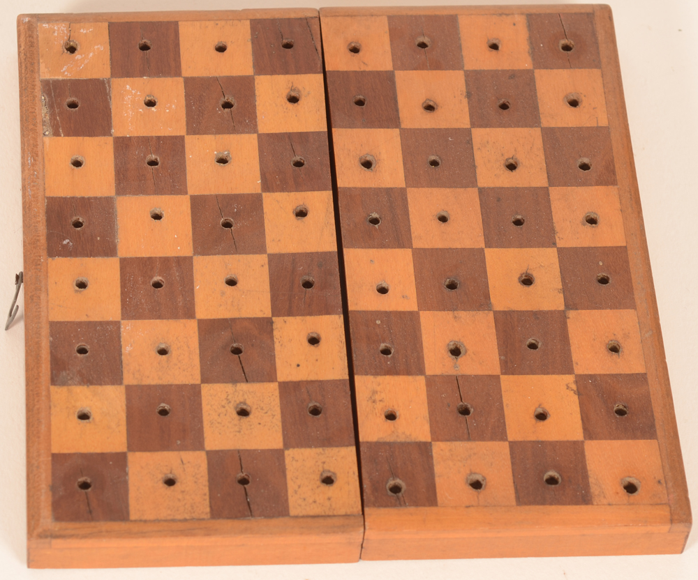 Travel chess set — the board with traces of use and age