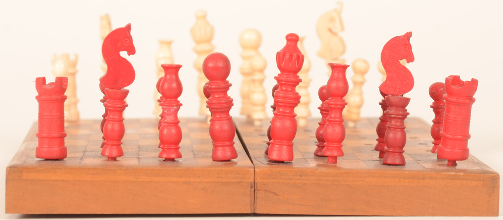 Travel chess set — Deatil of the red pawns, right horse restored