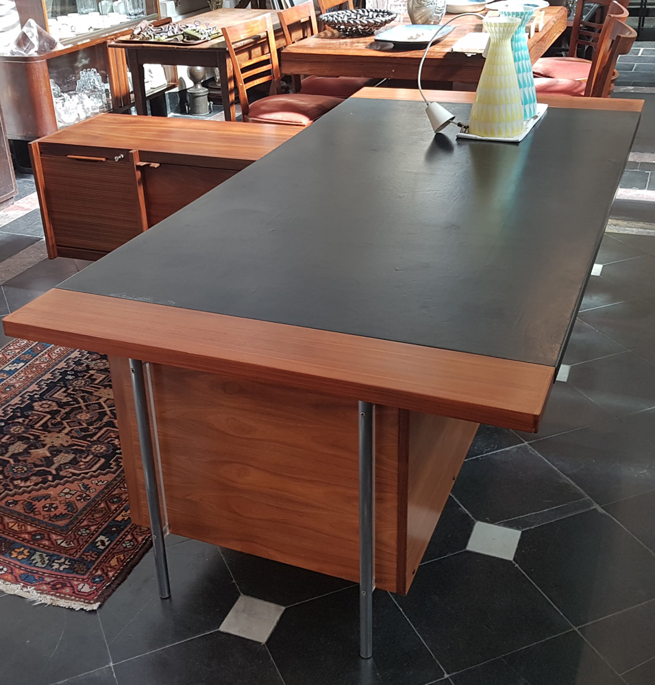 Vintage executive desk — the leather top, with traces of use