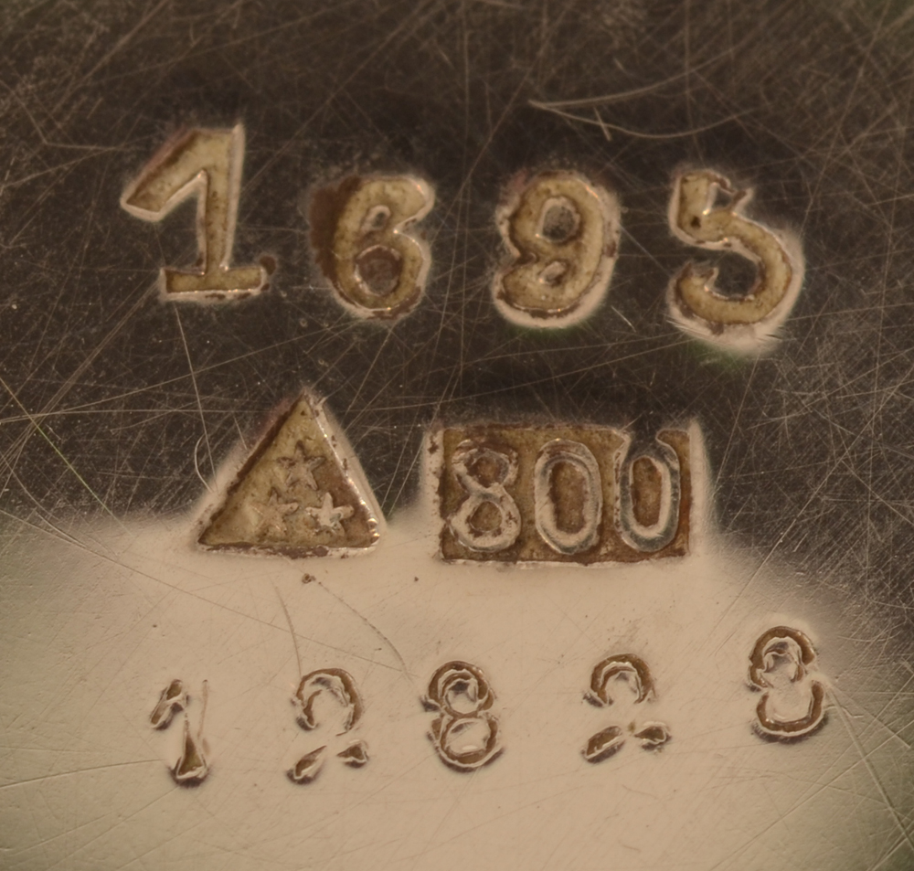 Wolfers Frères — Marks on the bottom of one of the items with model number, makers mark and alloy mark