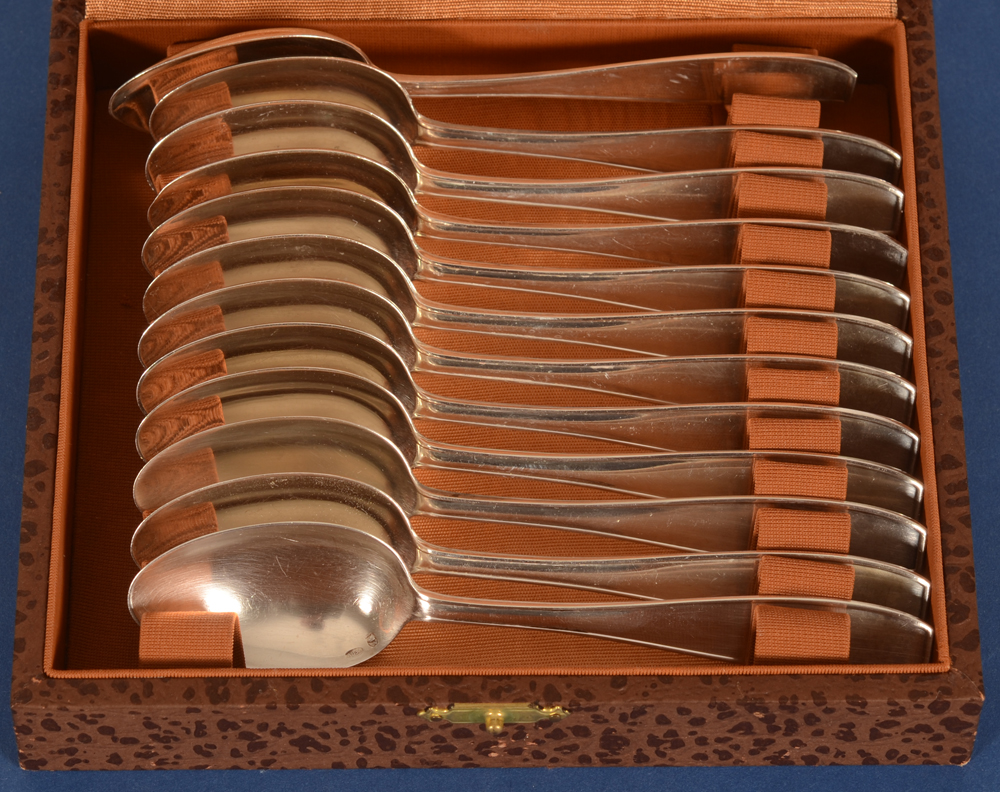 Wolfers Frères  — the set of silver spoons in their box