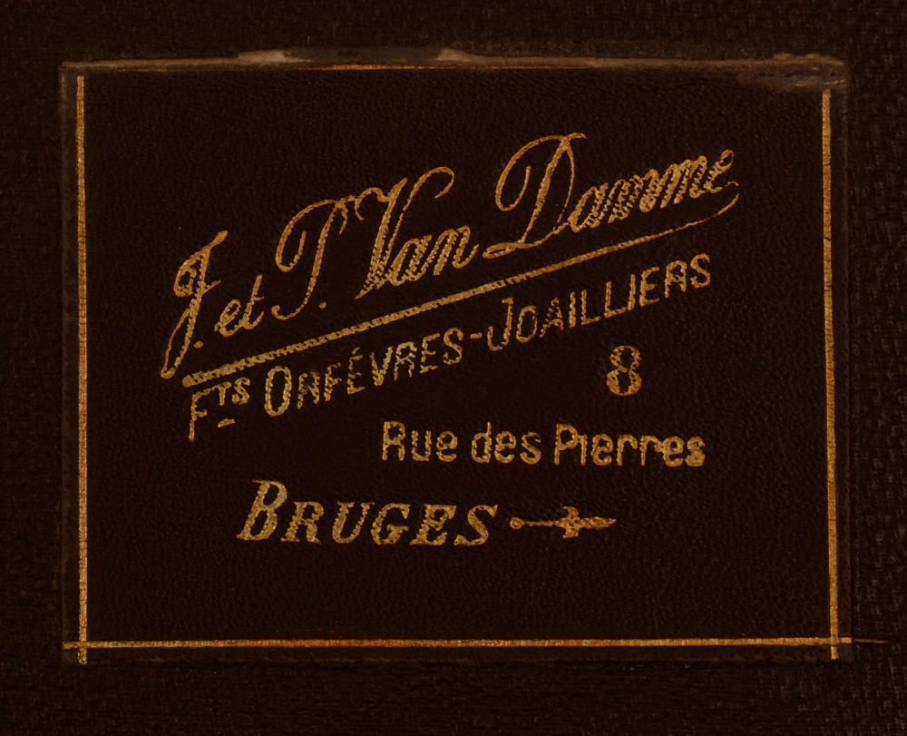 Wolfers Freres  — Mark of the retailer in Bruges through whom the set was sold at the time