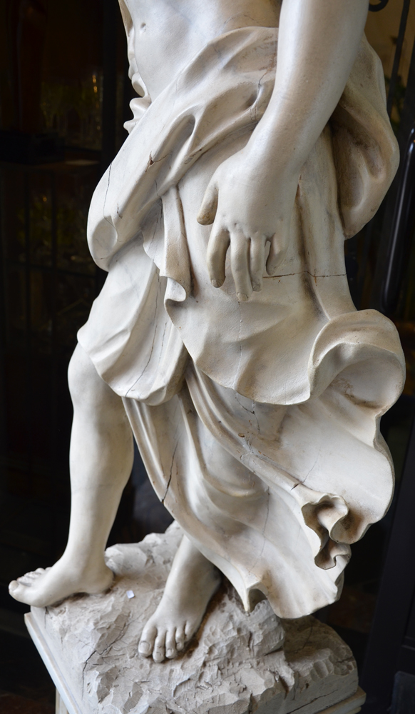 Wooden Statue — Detail of the drapery and the left hand
