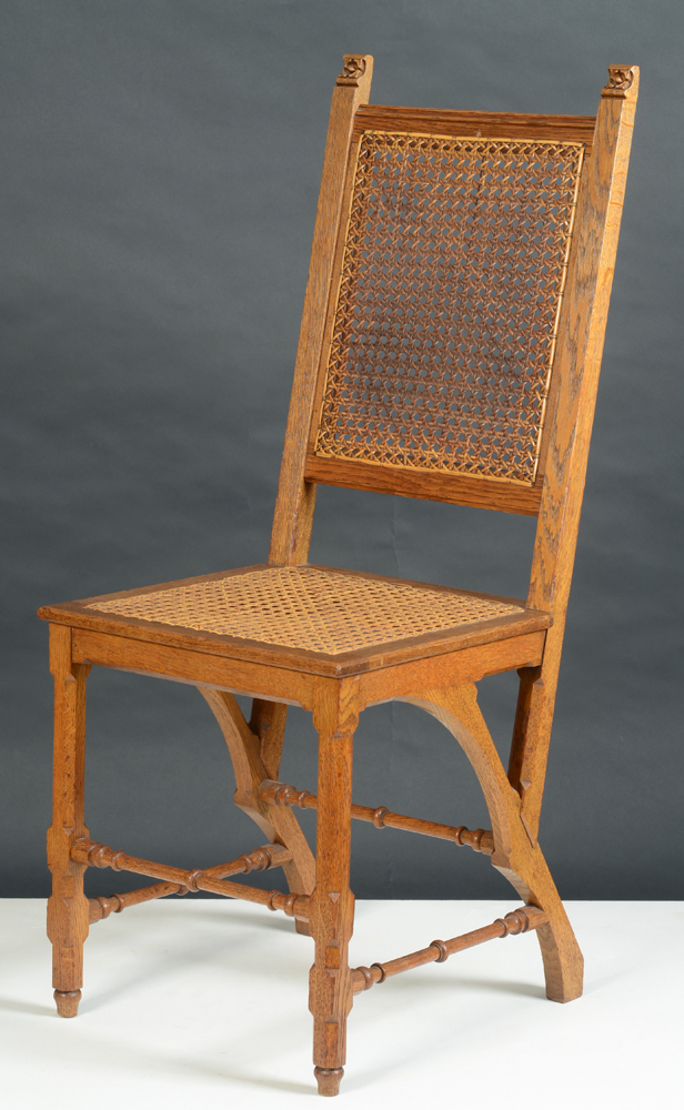 Matthias Zens — One of a set of six dining room chairs in oak, in Gothic Revival style.