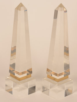 A pair of perspex or lucite obelisks