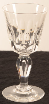 Set of cut crystal glasses on baluster stem